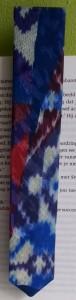 Detail boekenlegger stropdas
